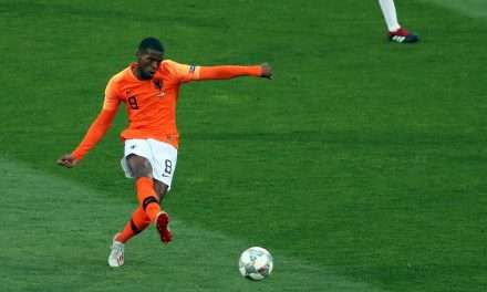 Ronald Koeman looks to Liverpool's Gini Wijnaldum